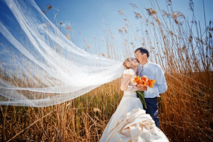 Kissing wedding couple during Fall