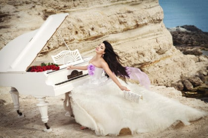 Bride playing Piano on Beach